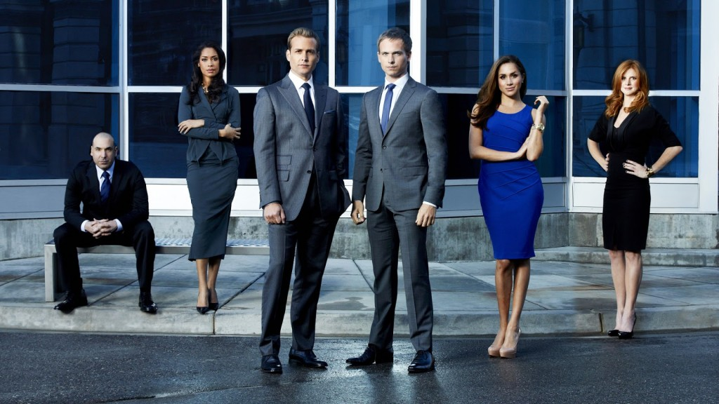SUITS -- Season: 2 -- Pictured: (l-r) Rick Hoffman as Louis Litt, Gina Torres as Jessica Pearson, Gabriel Macht as Harvey Specter, Patrick J. Adams as Mike Ross, Meghan Markle as Rachel Zane, Sarah Rafferty as Donna -- Photo by: Robert Ascroft/USA Network