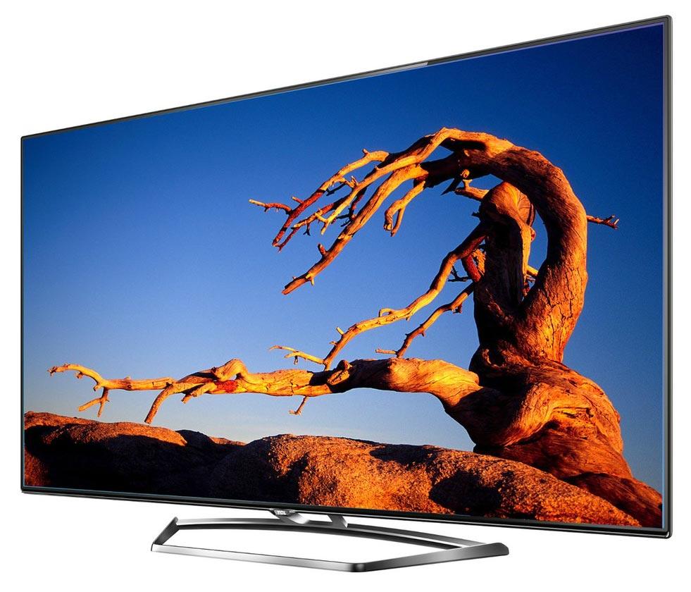Taki telewizor TCL znajduje się w moim salonie.