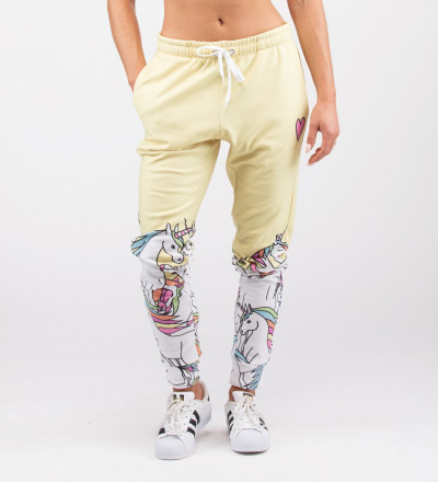 yellow sweatpants with unicorn motive