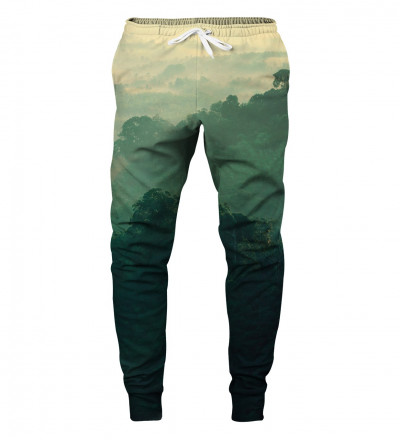 green sweatpants with forest motive