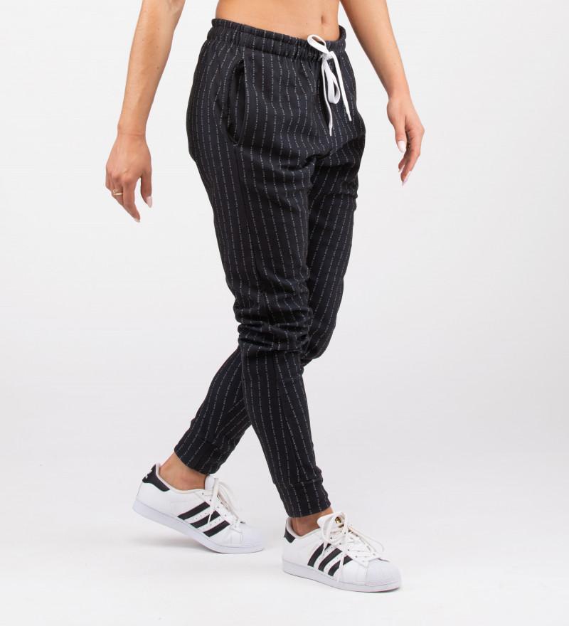 czarne damskie spodnie z napisem fk you