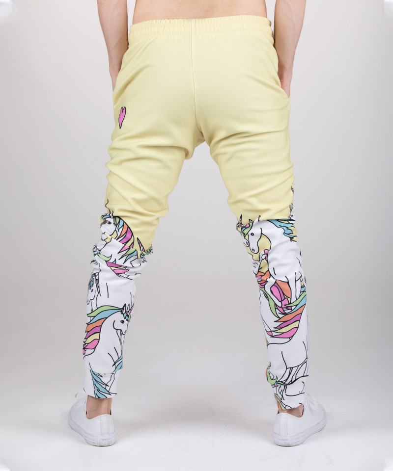 yellow sweatpants with unicorn motive